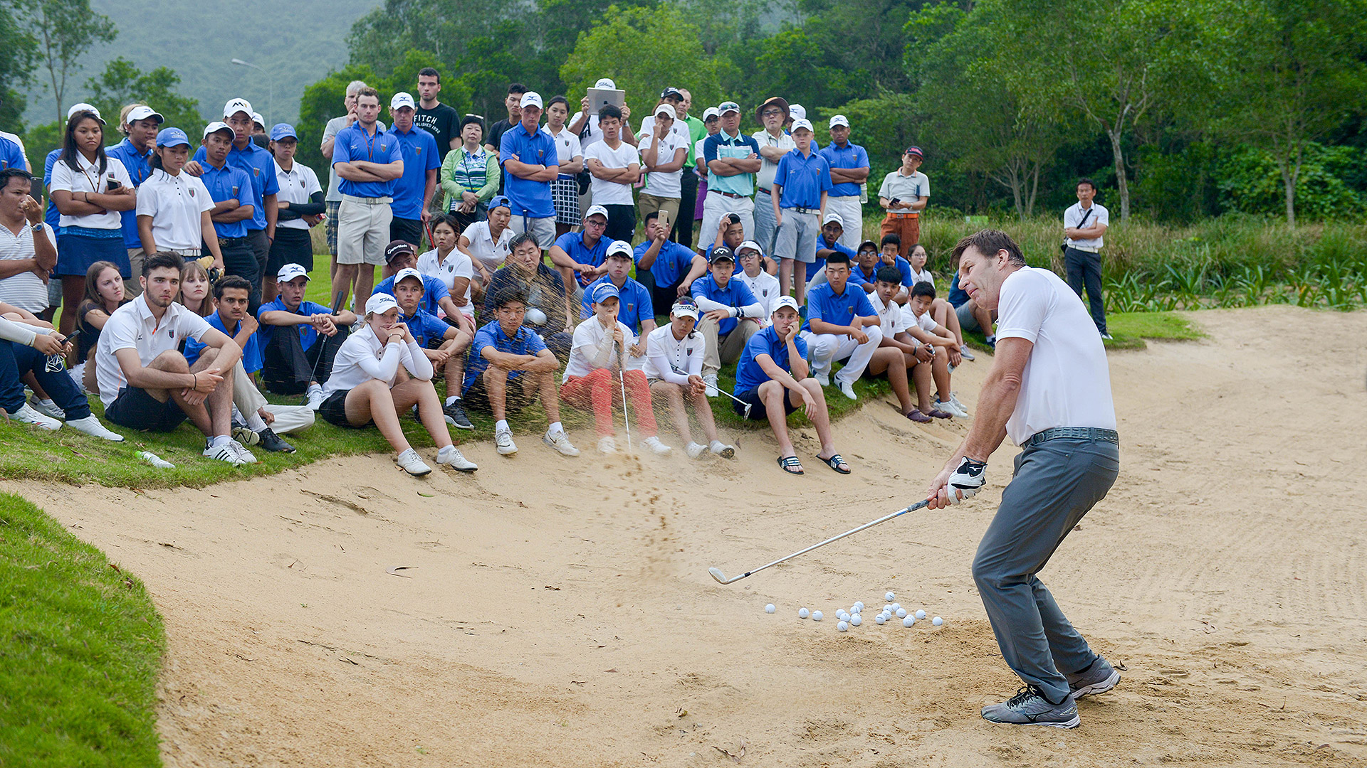 Sir Nick Faldo with young golfers at the 11th Faldo Series Asia Grand Final