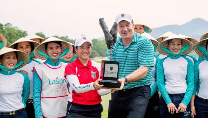Suzuka Yamaguchi poses with Sir Nick Faldo and Laguna Lăng Cô caddies after her historic victory